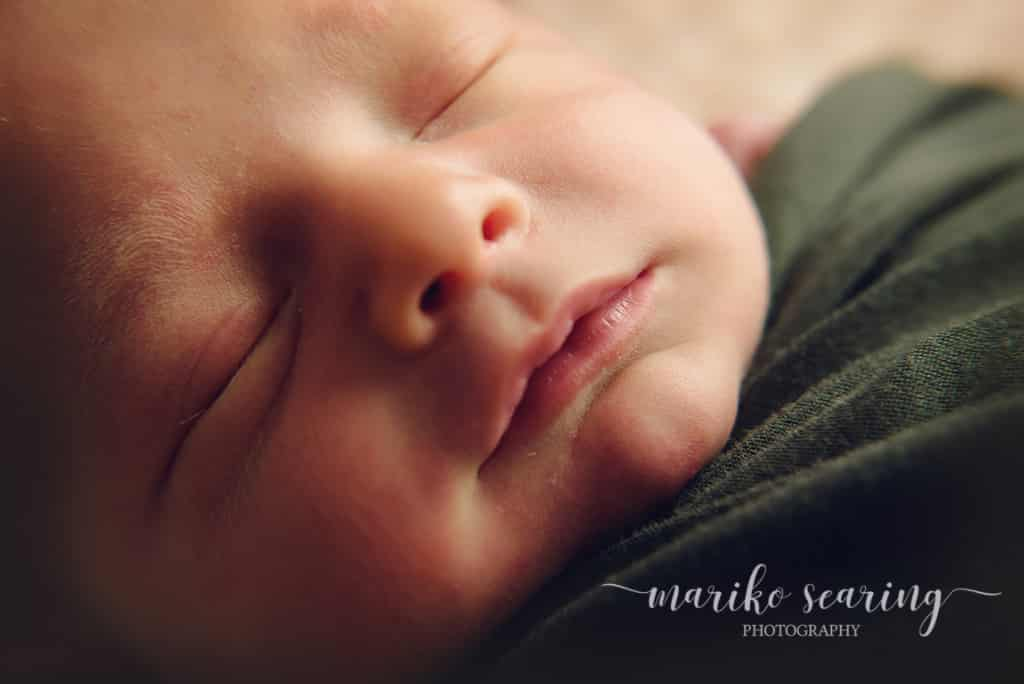 wrapped baby close up in Baton Rouge by newborn photographer
