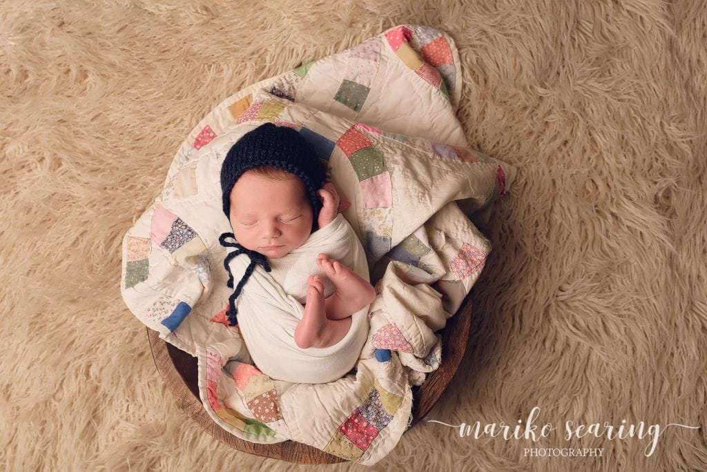 studio wrapped newborn in bowl with quilt in Denham SPrings by newborn photographer