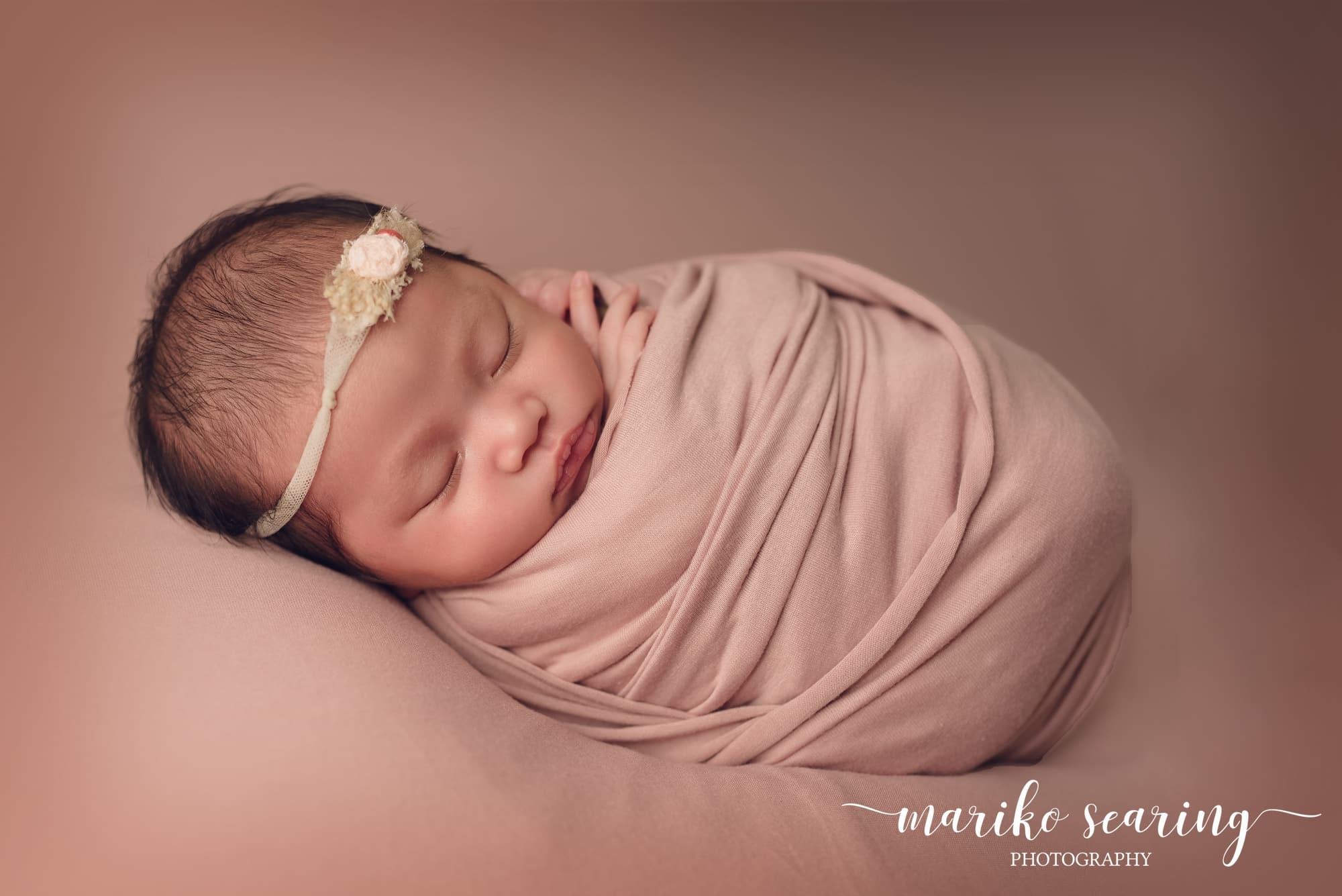 wrapped baby by newborn photographer in Baton Rouge