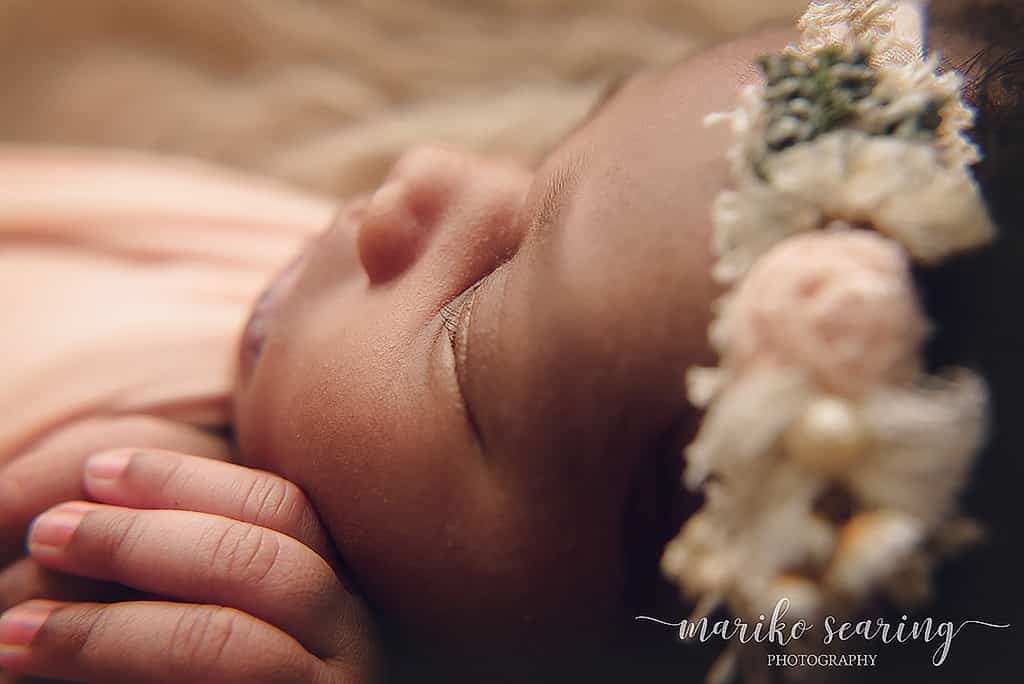 close up on wrapped baby by Baton Rouge boutique newborn photographer