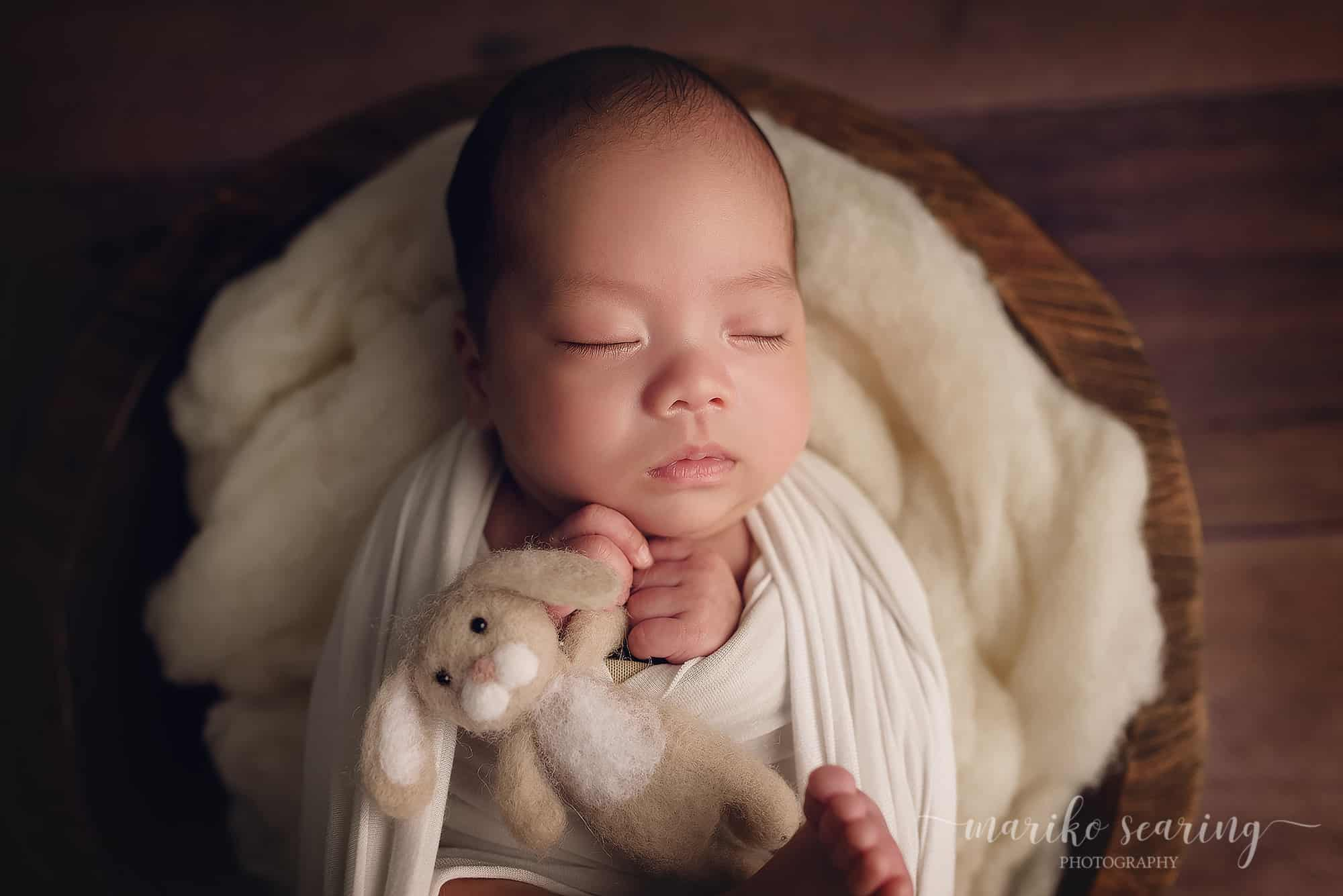 03052018 classic posed baton rouge newborn photographer white wrapped sleeping baby in bowl with felt rabbit close up