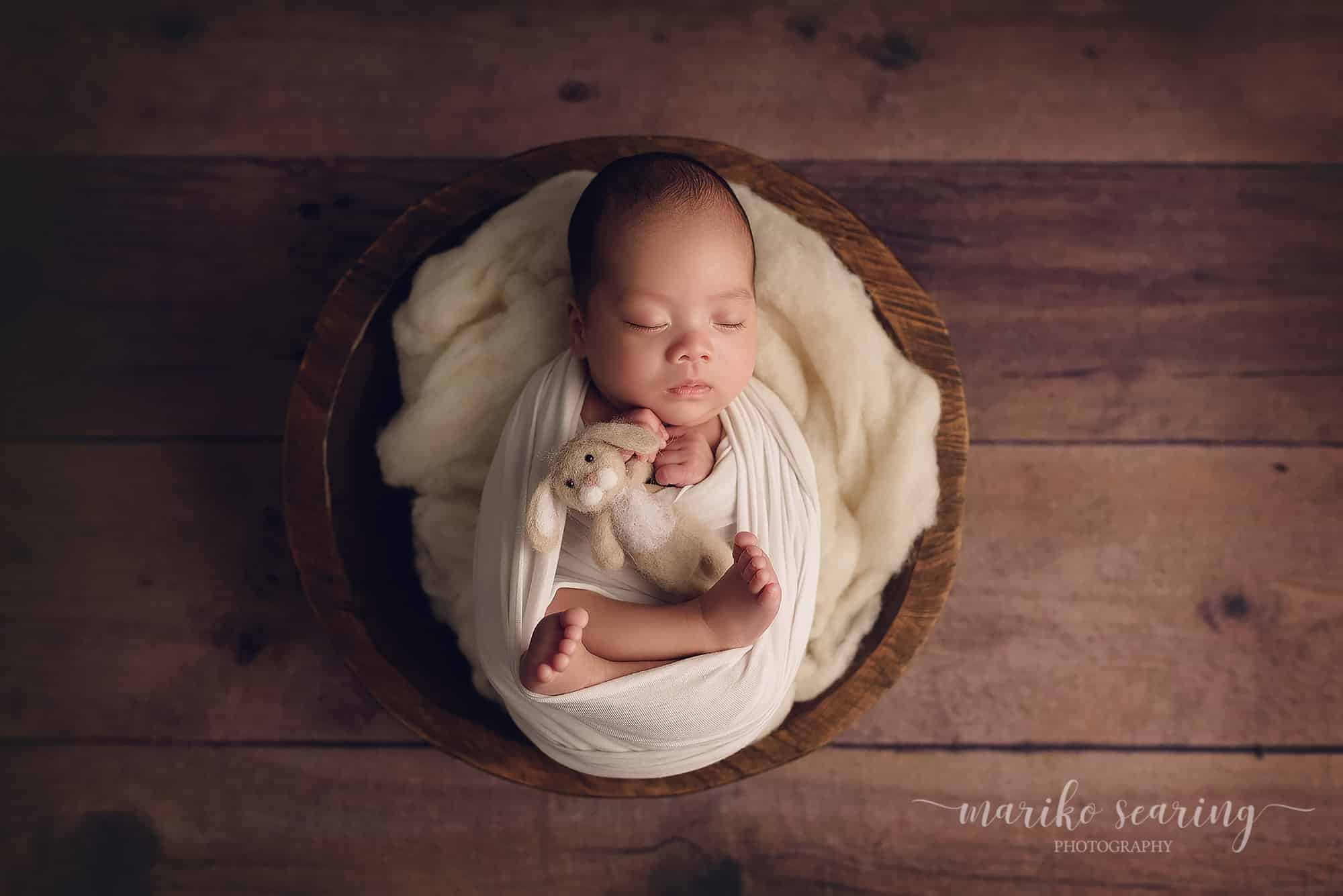 03052018 classic posed baton rouge newborn photographer white wrapped sleeping baby in bowl with felt rabbit