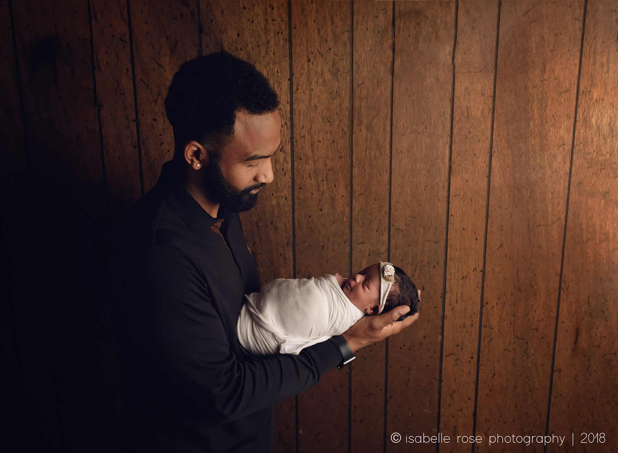 07172018 baton rouge la infant photographer father holding wrapped baby