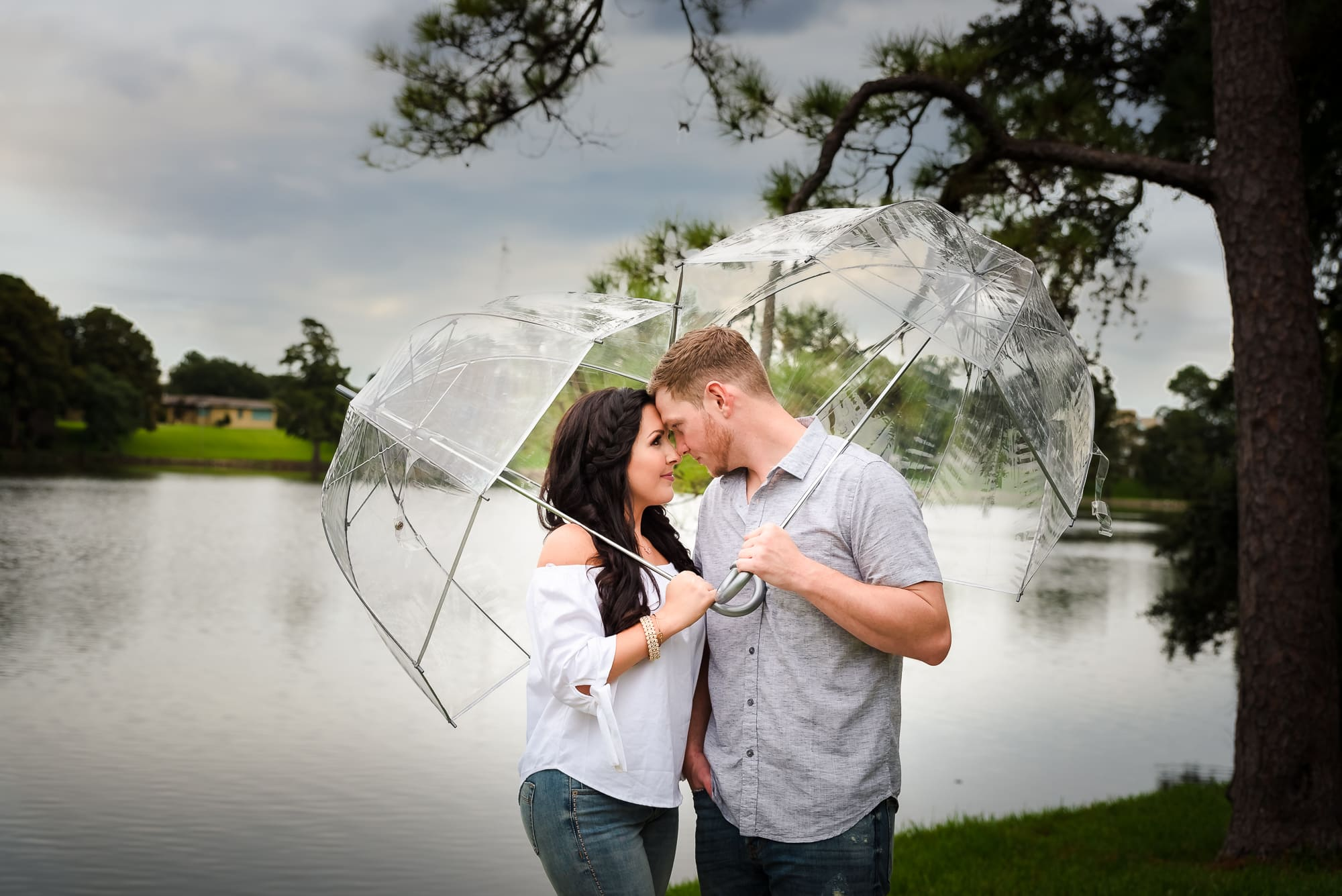 couple standing with umbrellas