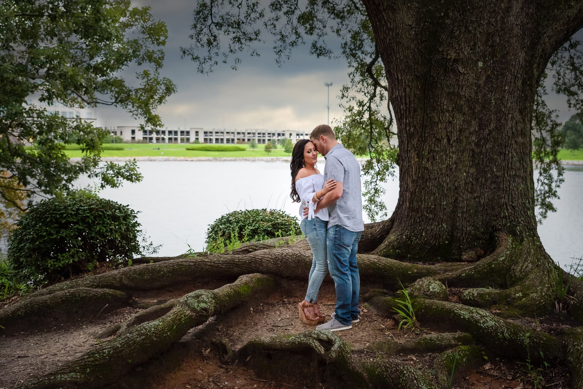couple standing under a tree