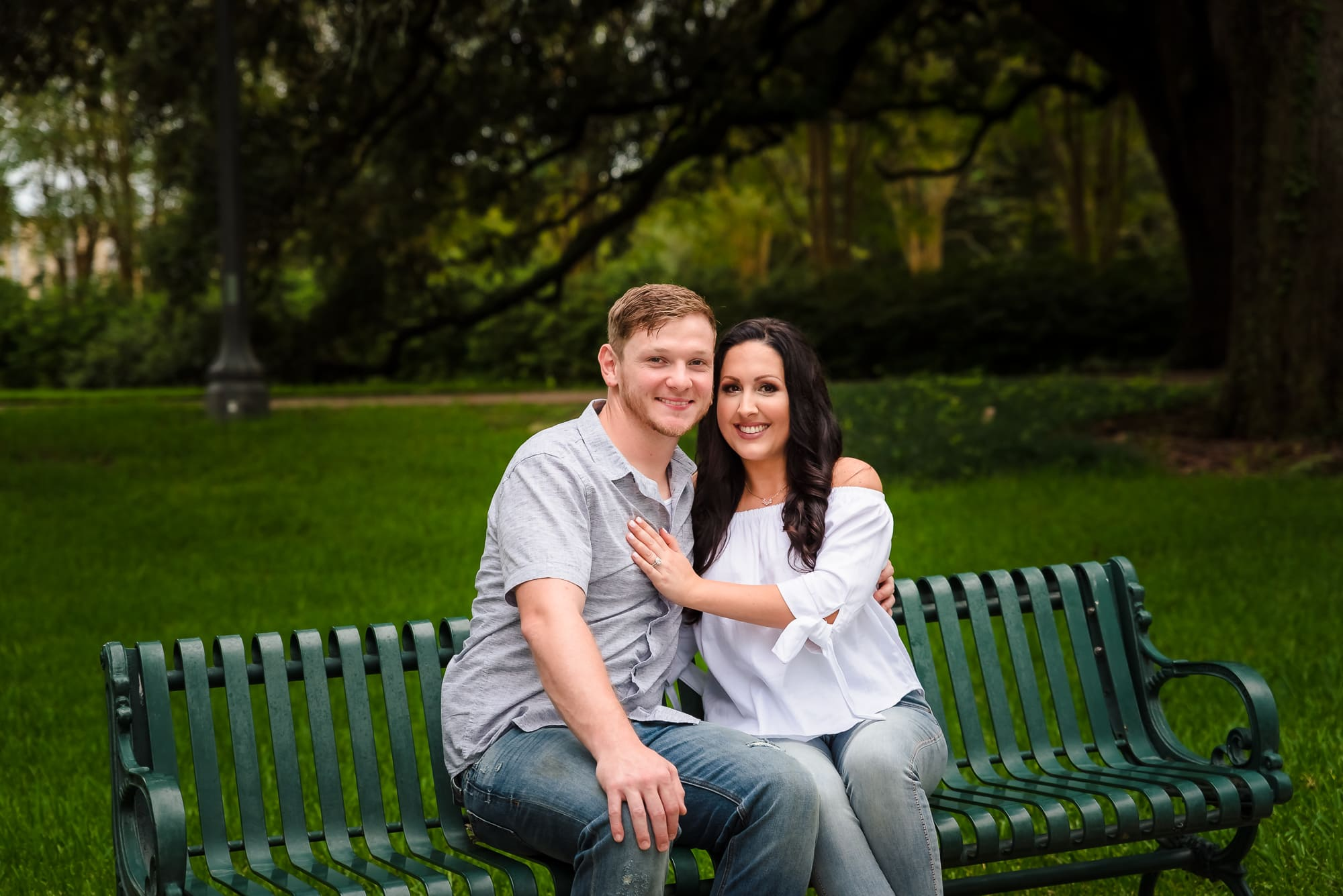 couple sitting on s bench