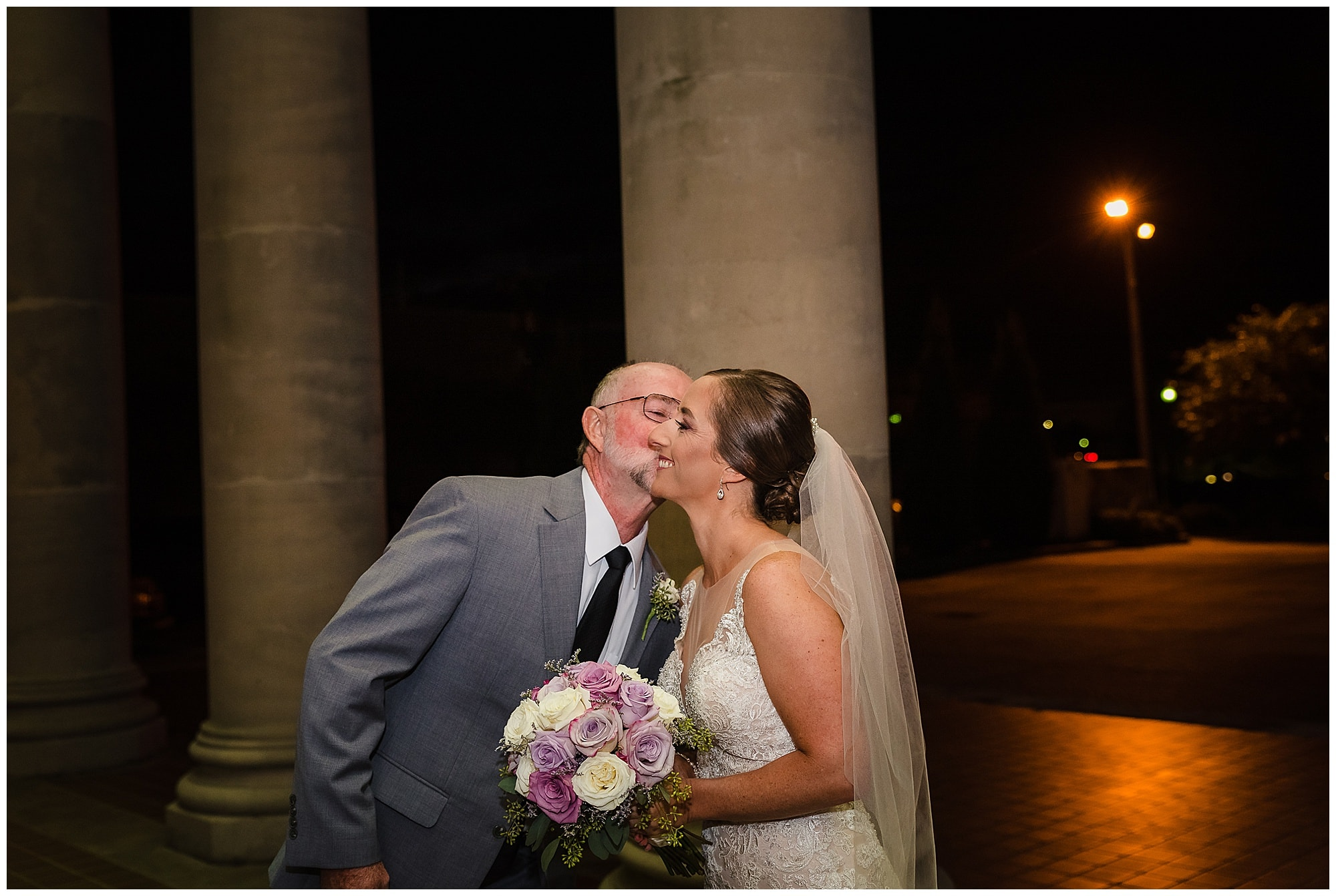 Father of the bride kissing bride before ceremony