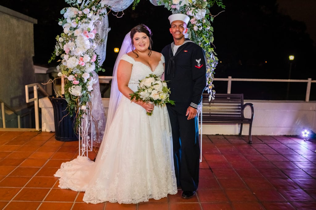 Bridal Couple posing at the alter at Baton Rouge gallery venue
