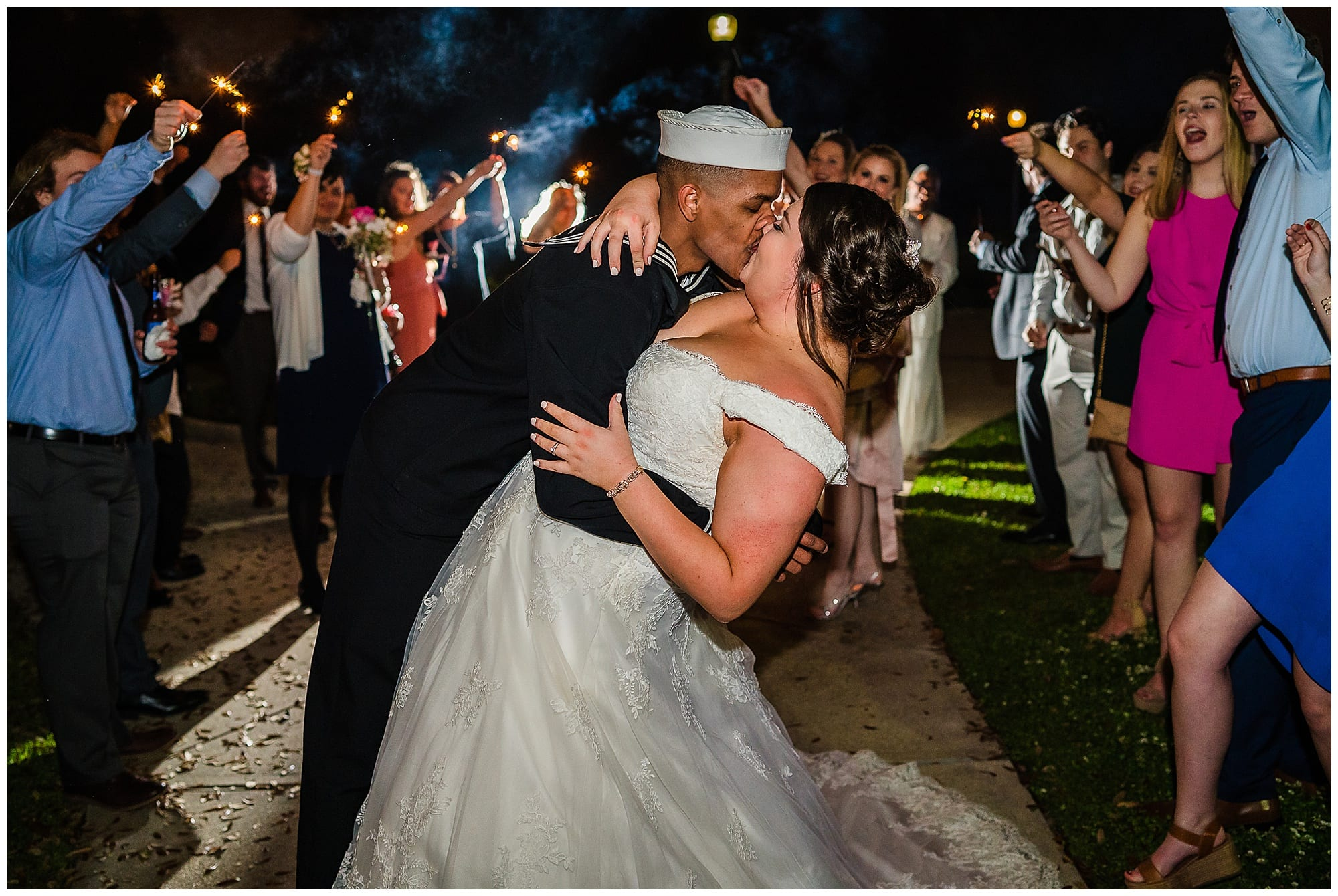 groom dips bride and they kiss with sparklers at Baton Rouge gallery venue