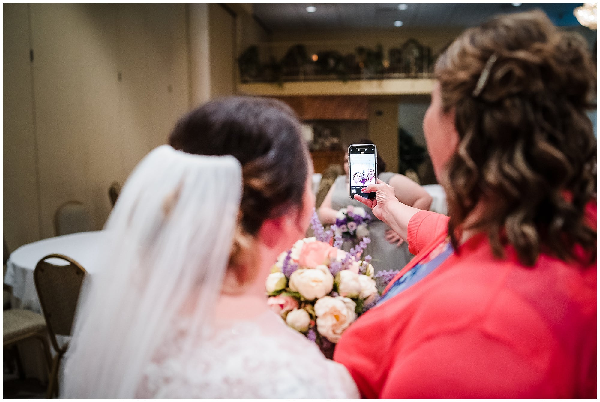 bride and guest taking a selfie at Cypress Columns Louisiana wedding venue