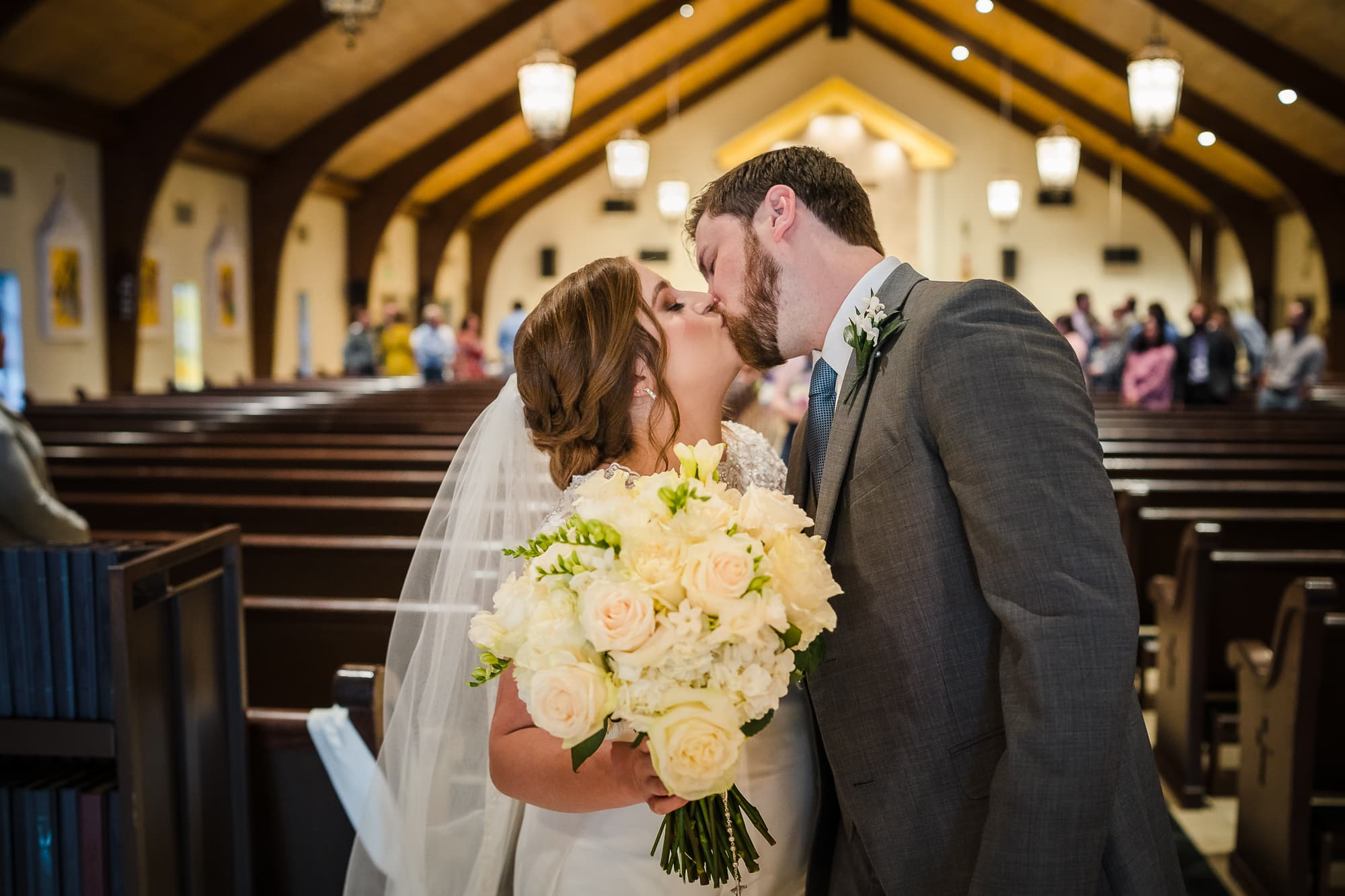 couple kissing in a church