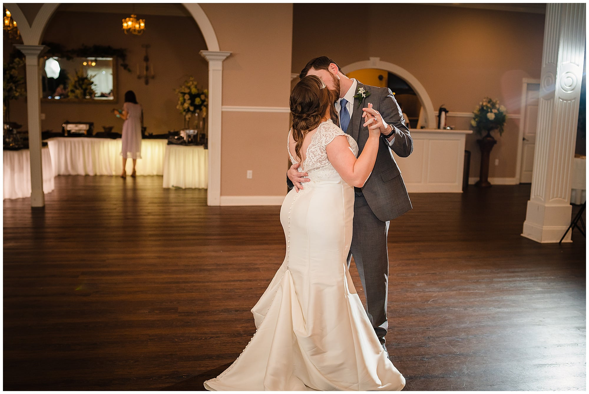 bride and groom kiss during first dance at Forrest Grove Plantation Denham Springs