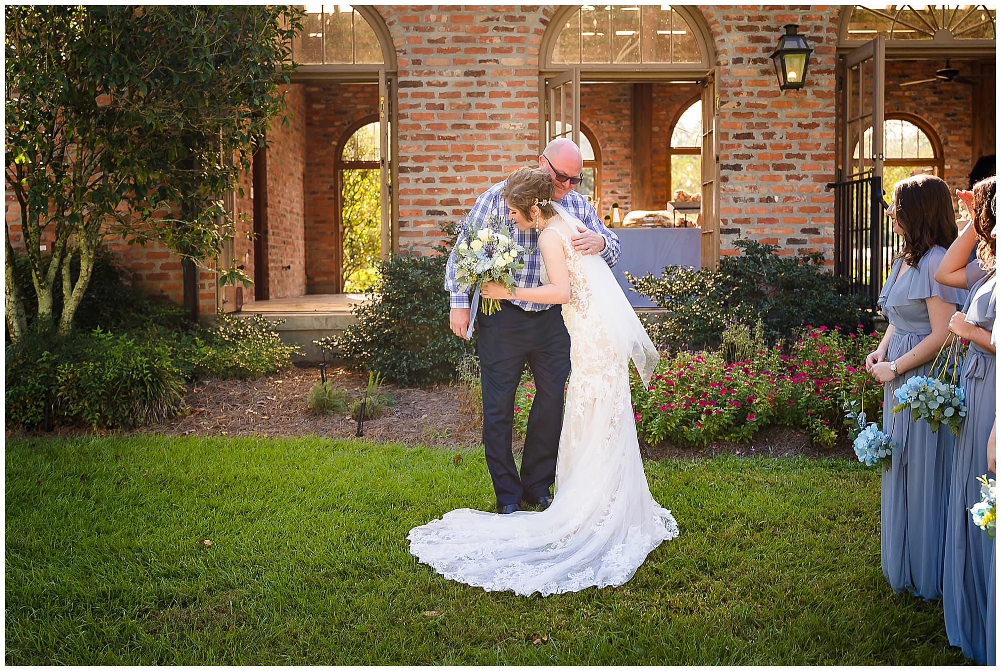 bride hugging father Orangerie wedding in Baton Rouge
