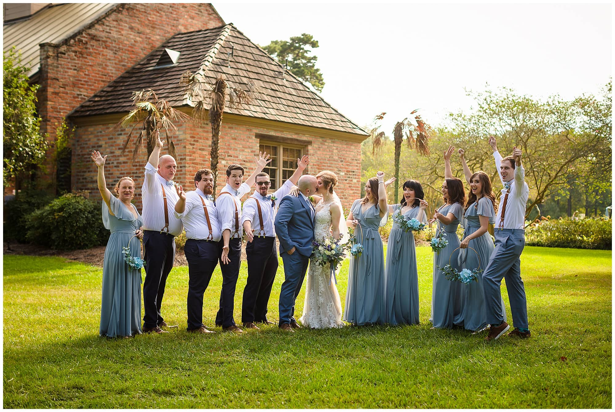 bridal party cheering kissing couple Orangerie wedding in Baton Rouge