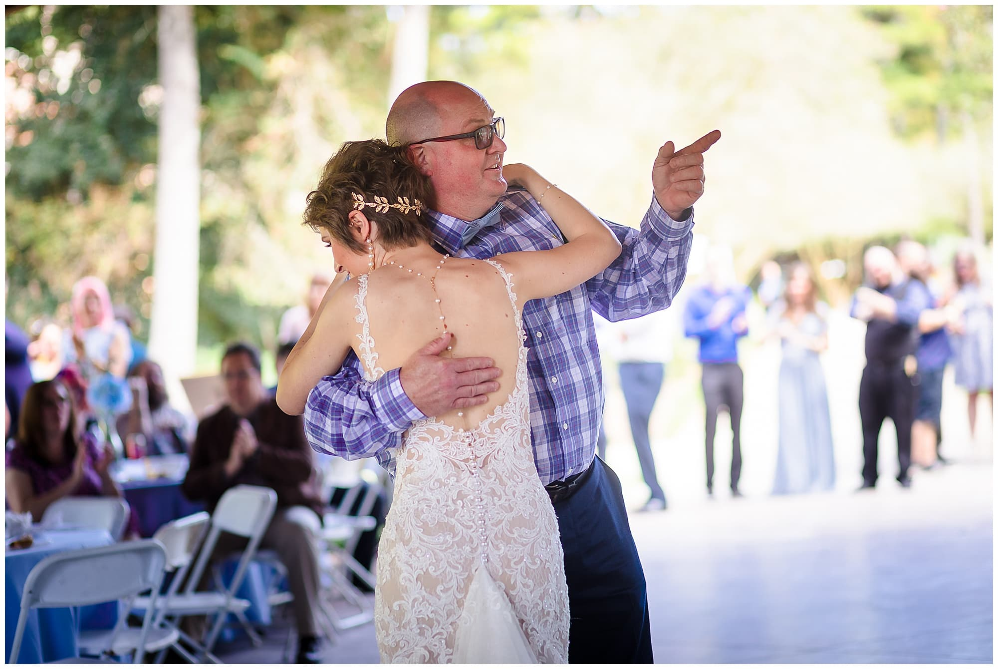 bride dancing with father Orangerie wedding in Baton Rouge