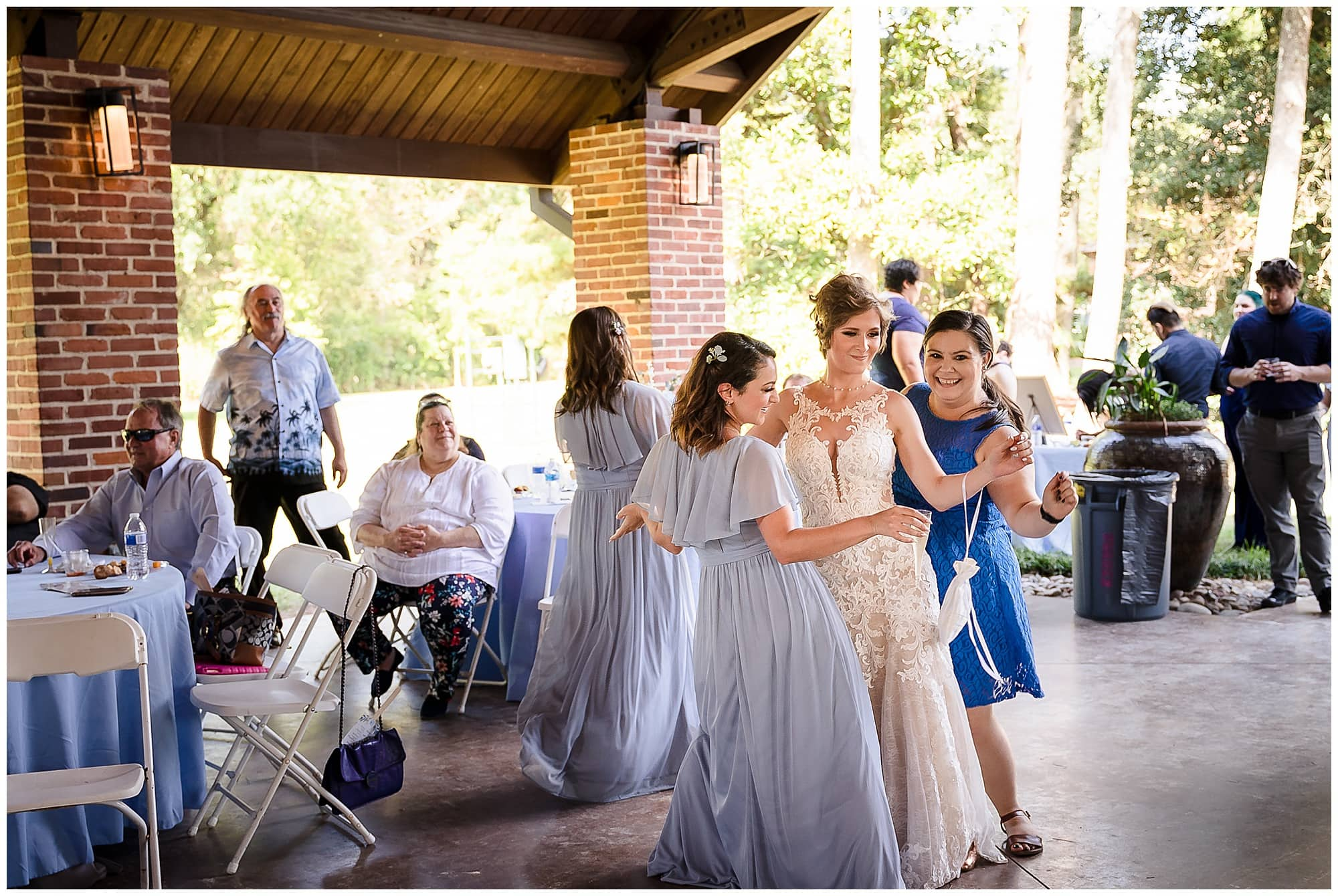 bride dancing with bridesmaid and friend Orangerie wedding in Baton Rouge