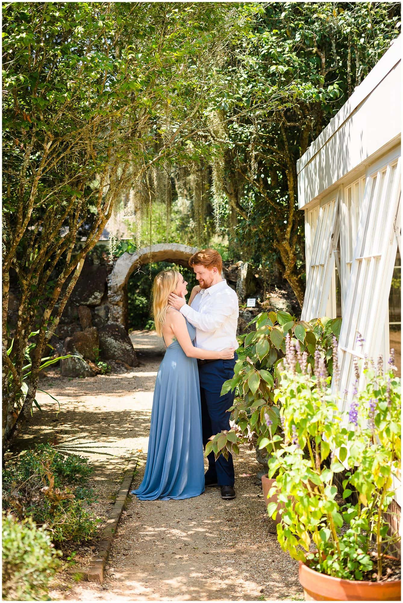 couple standing in a garden at St. Francisville Rosedown Plantation Engagement Session