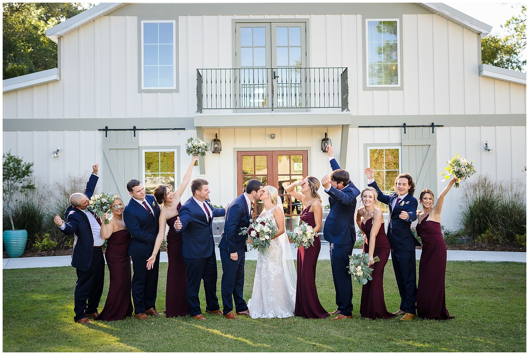 The Sadie Jane Wedding Venue bridal party cheering kissing couple