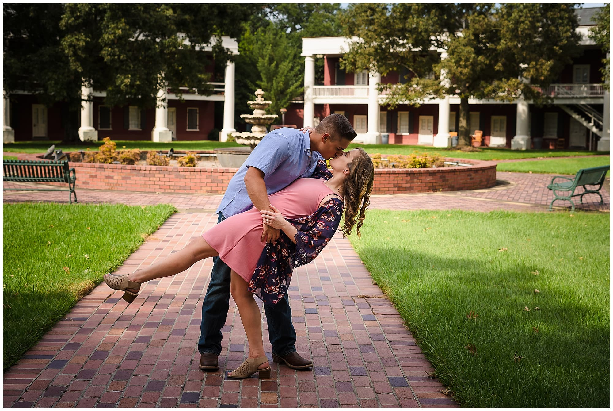man dips woman in downtown Baton Rouge engagement session