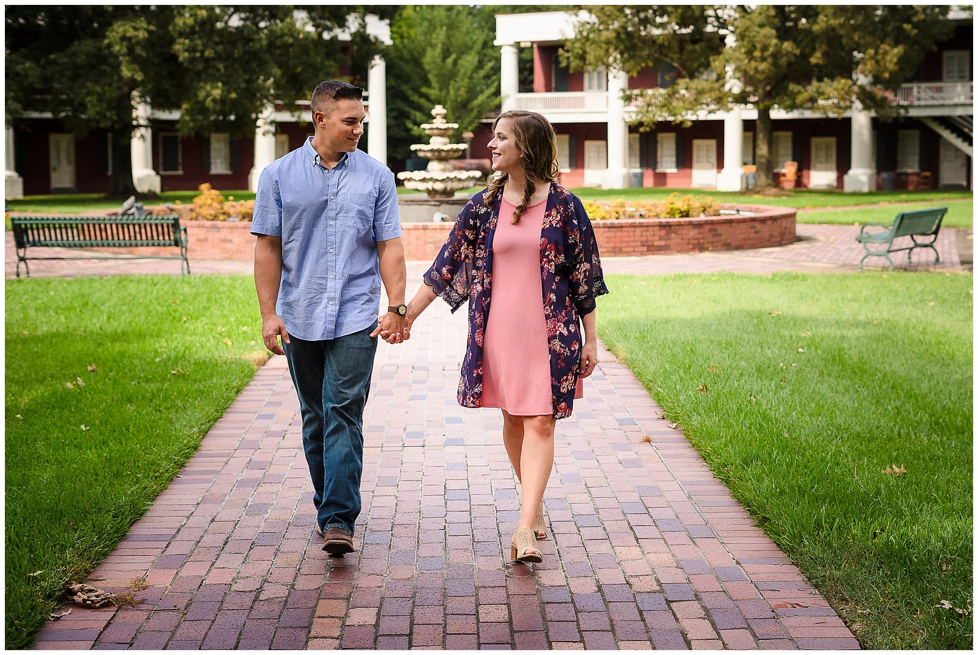 couple holding hands walking downtown Baton Rouge engagement session