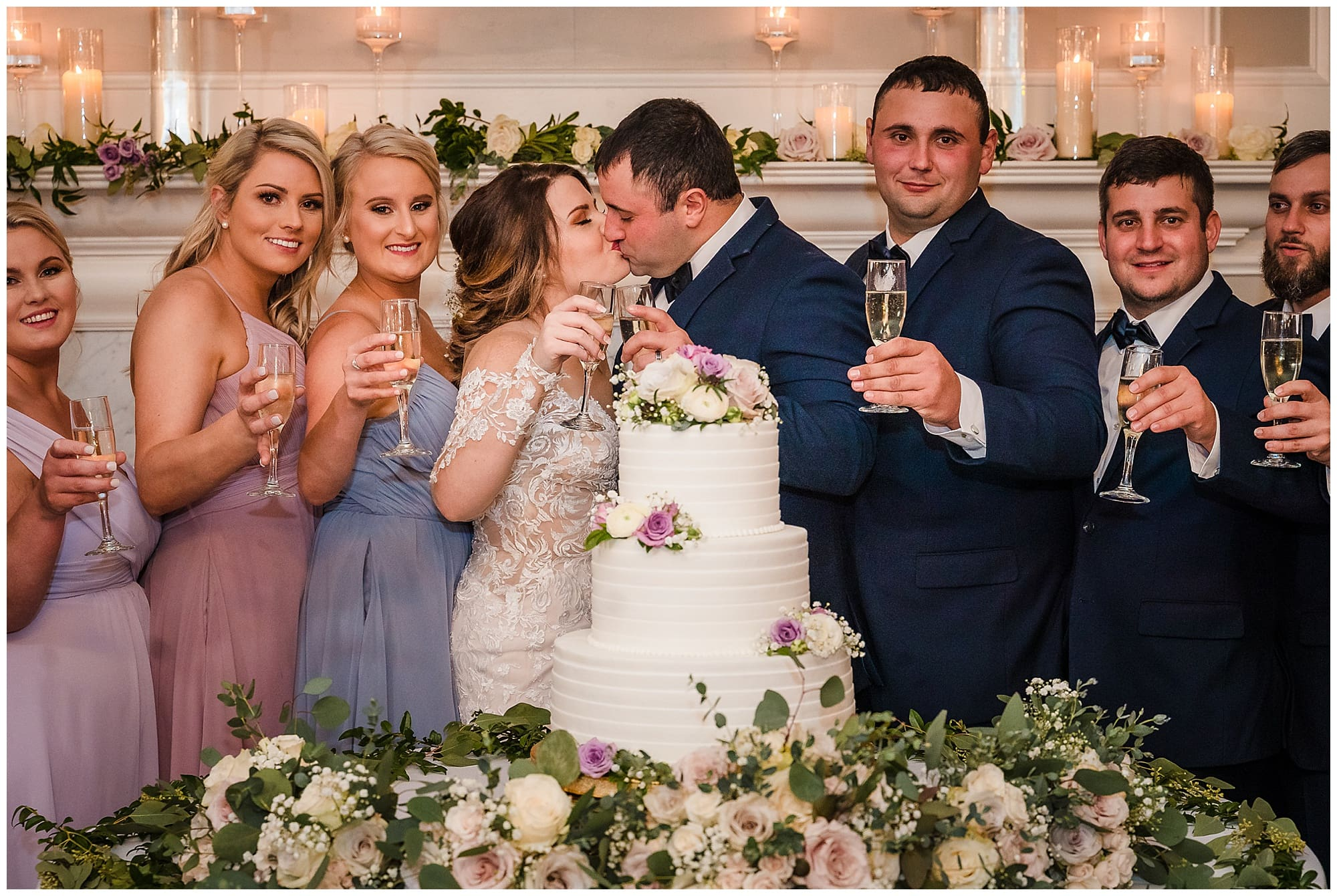 bride and groom kiss during toast