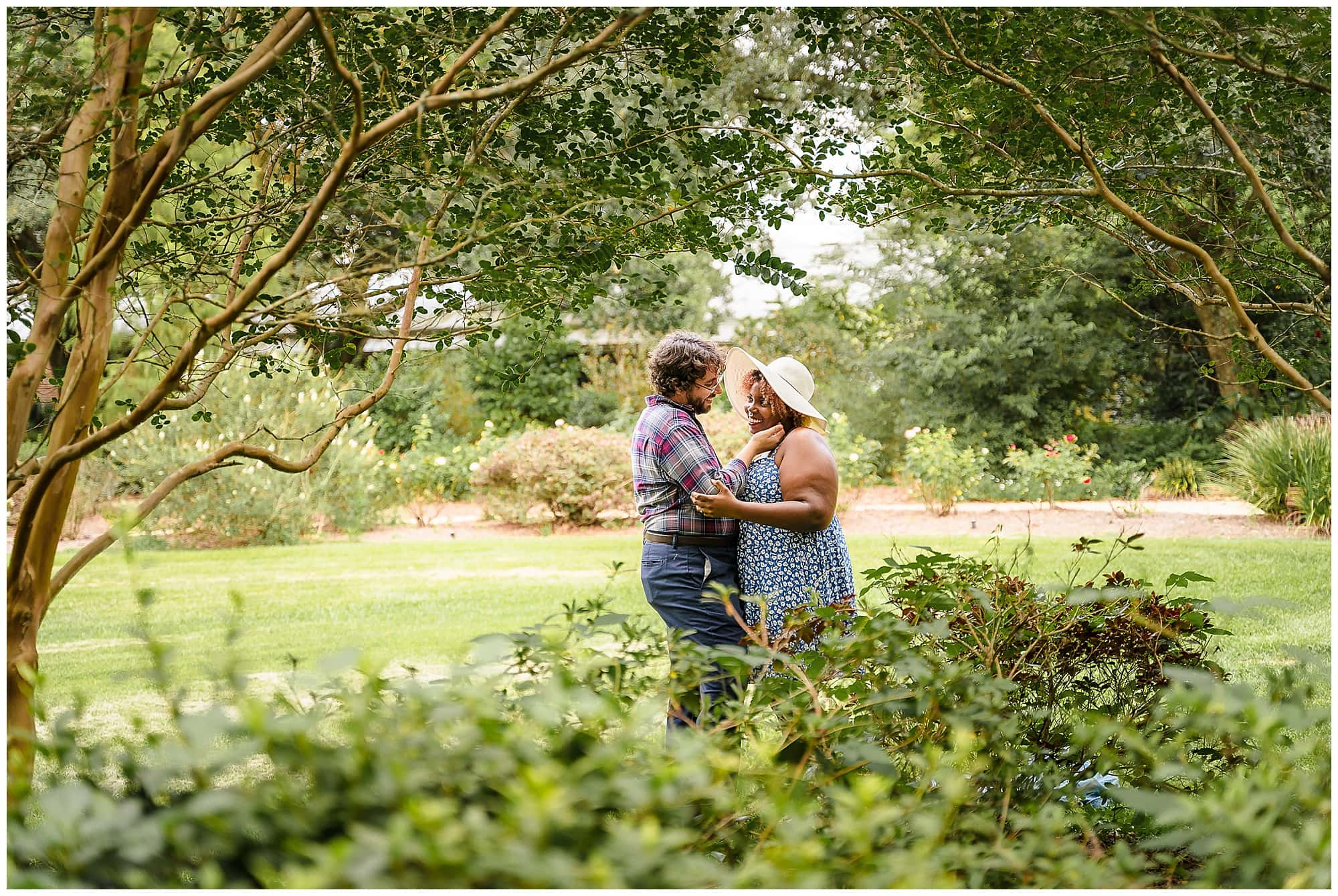 man holding woman's face in in Windrush Gardens Baton Rouge engagement session