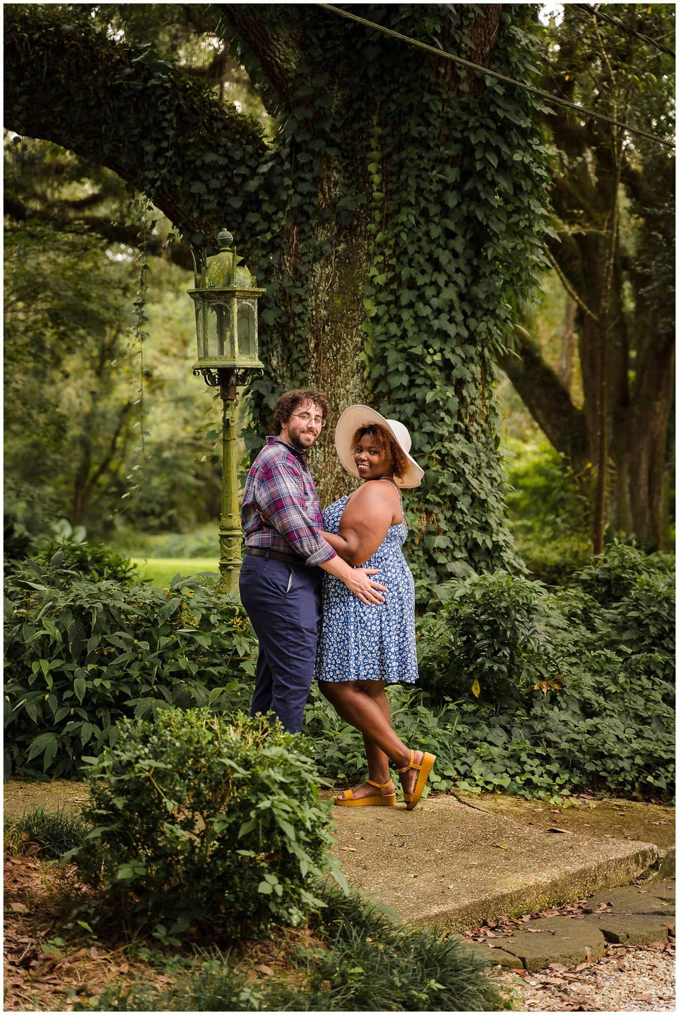 couple holing each other in Windrush Gardens Baton Rouge engagement session