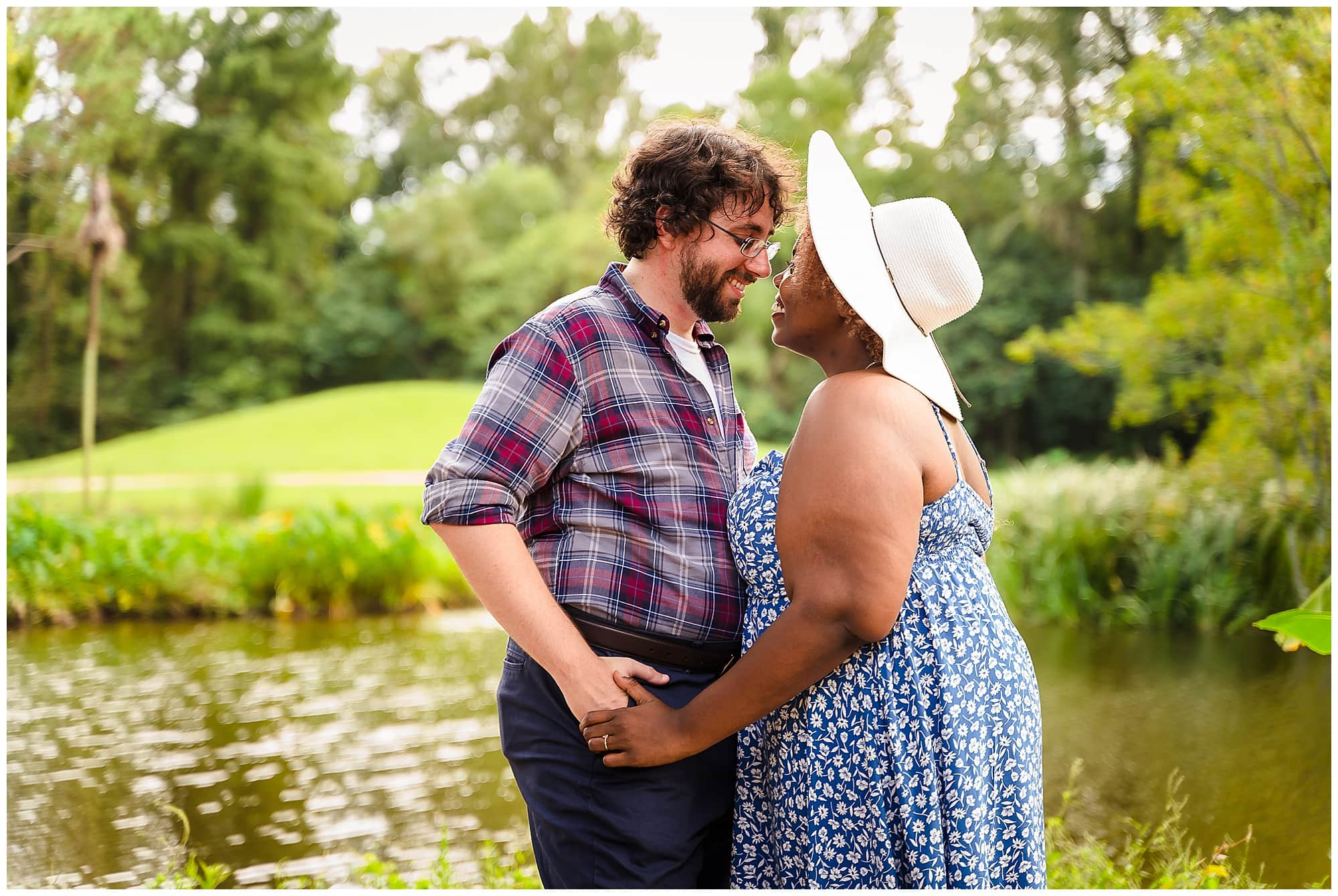 couple smiling at each other in Windrush Gardens Baton Rouge engagement session