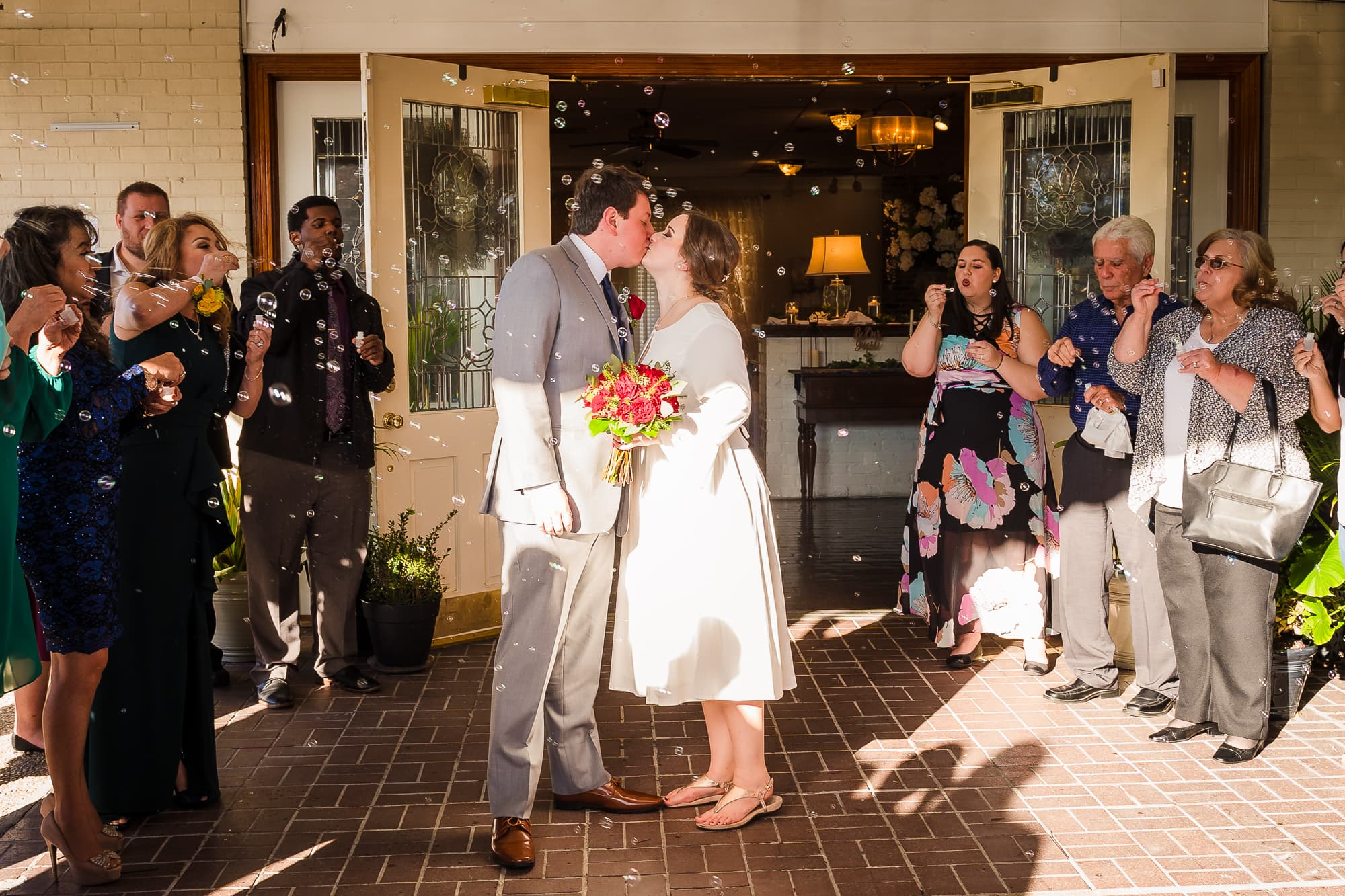5 tips for planning your wedding during a pandemic bride and groom kissing with bubbles