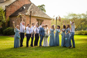 5 Tips For Planning Your Wedding During A Pandemic bridal party cheering kissing couple