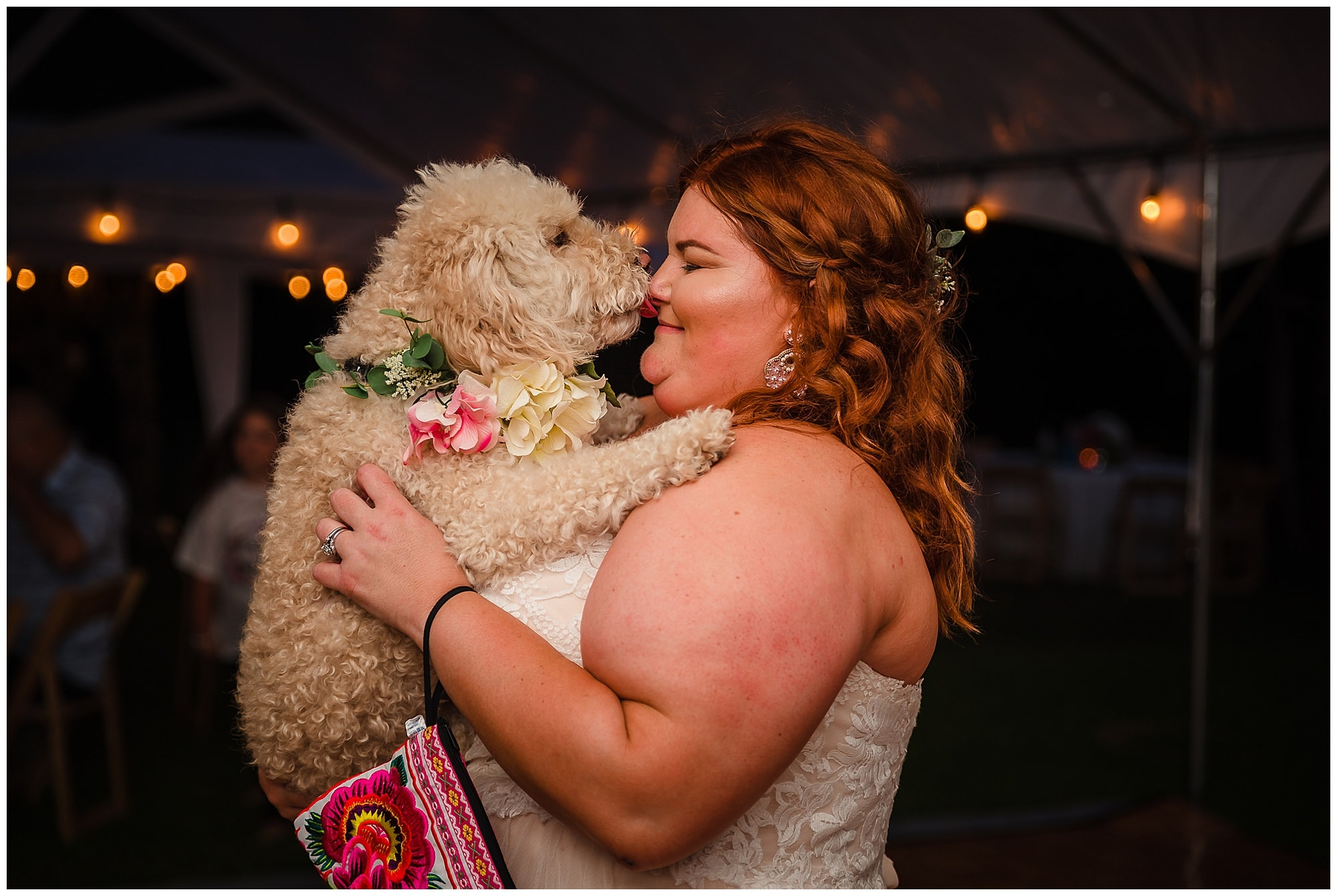 rustic Louisiana wedding dog kissing bride