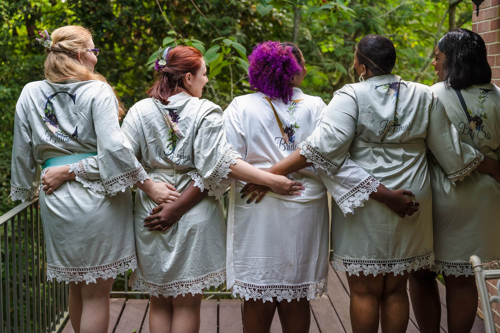 The Gatehouse Baton Rouge Wedding bridal party in robes