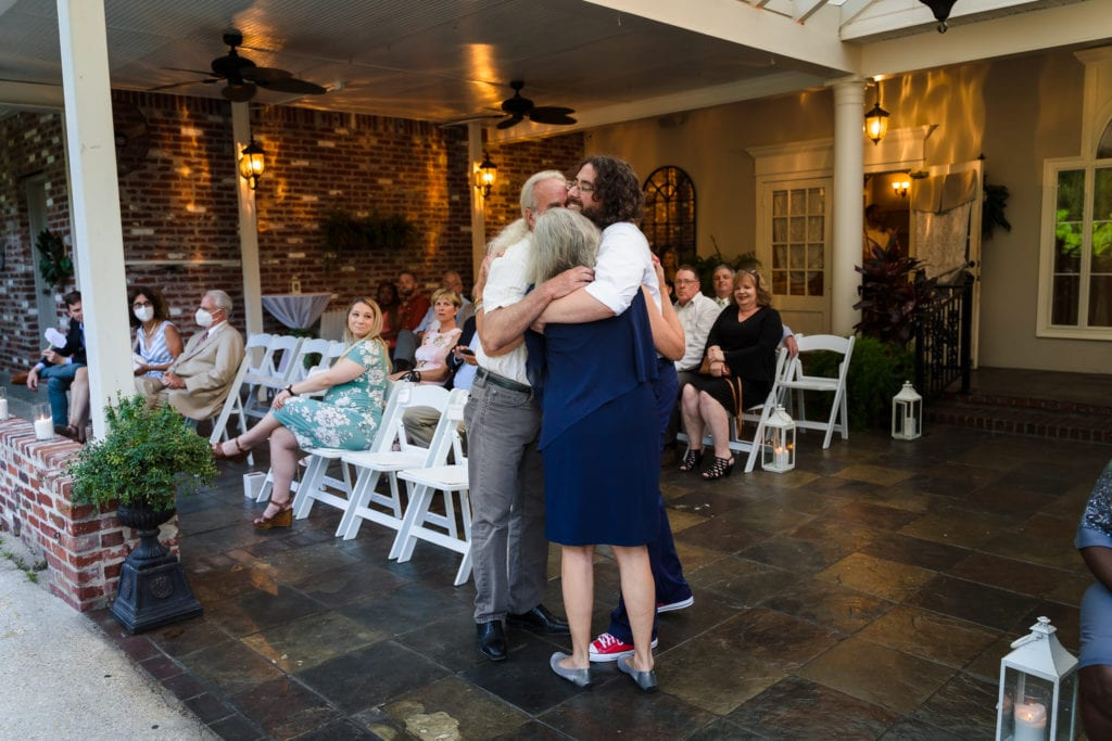 The Gatehouse Baton Rouge Wedding groom hugging parents