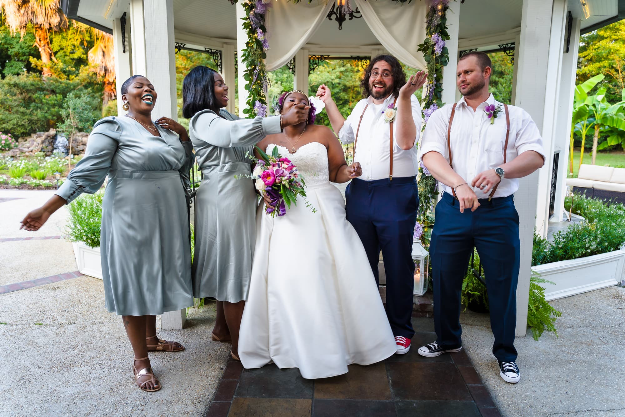 The Gatehouse Baton Rouge Wedding bridal party being silly