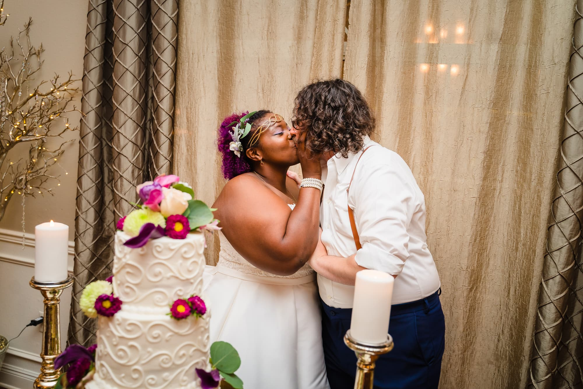 The Gatehouse Baton Rouge Wedding kissing next to cake