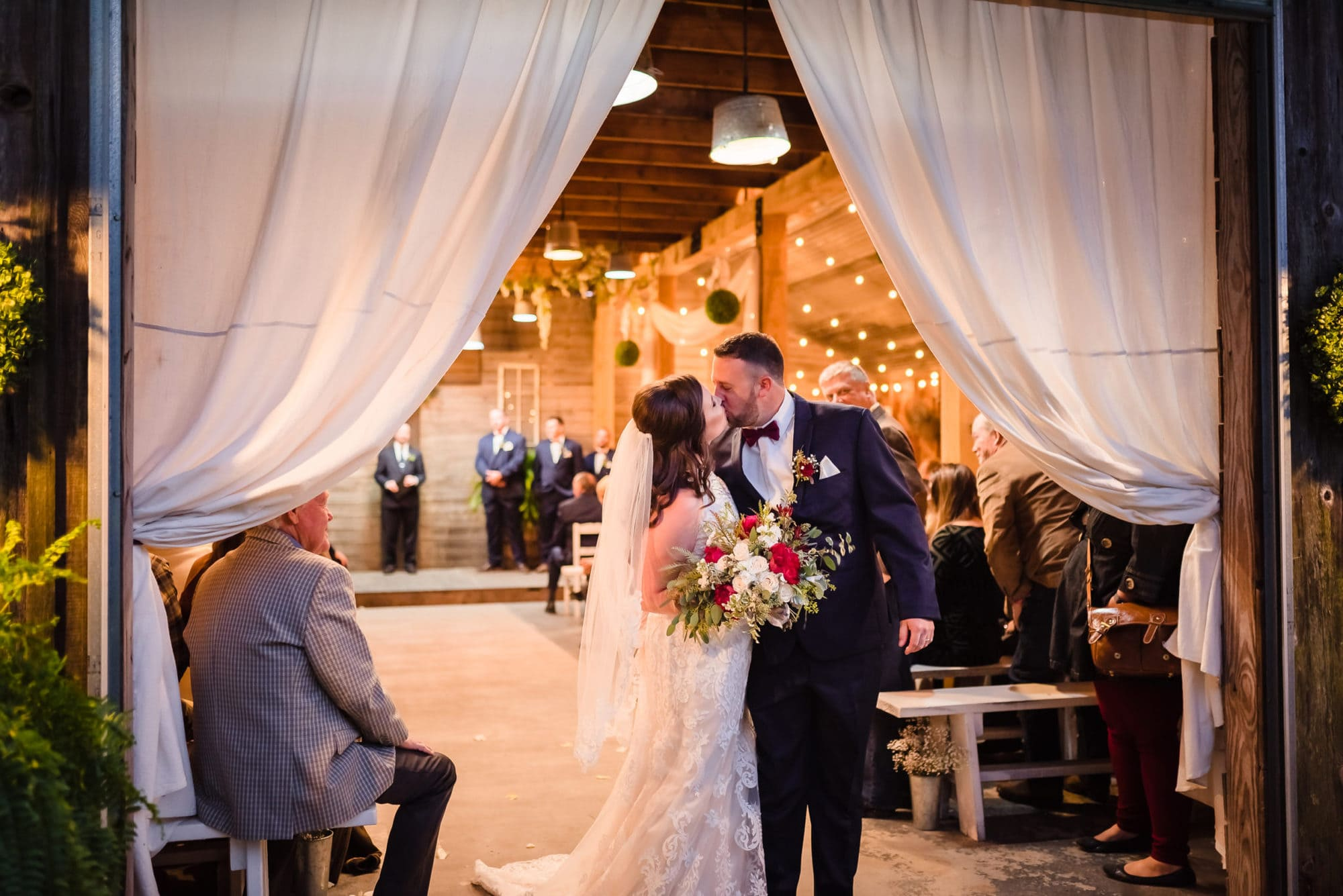 couple kissing after ceremony
