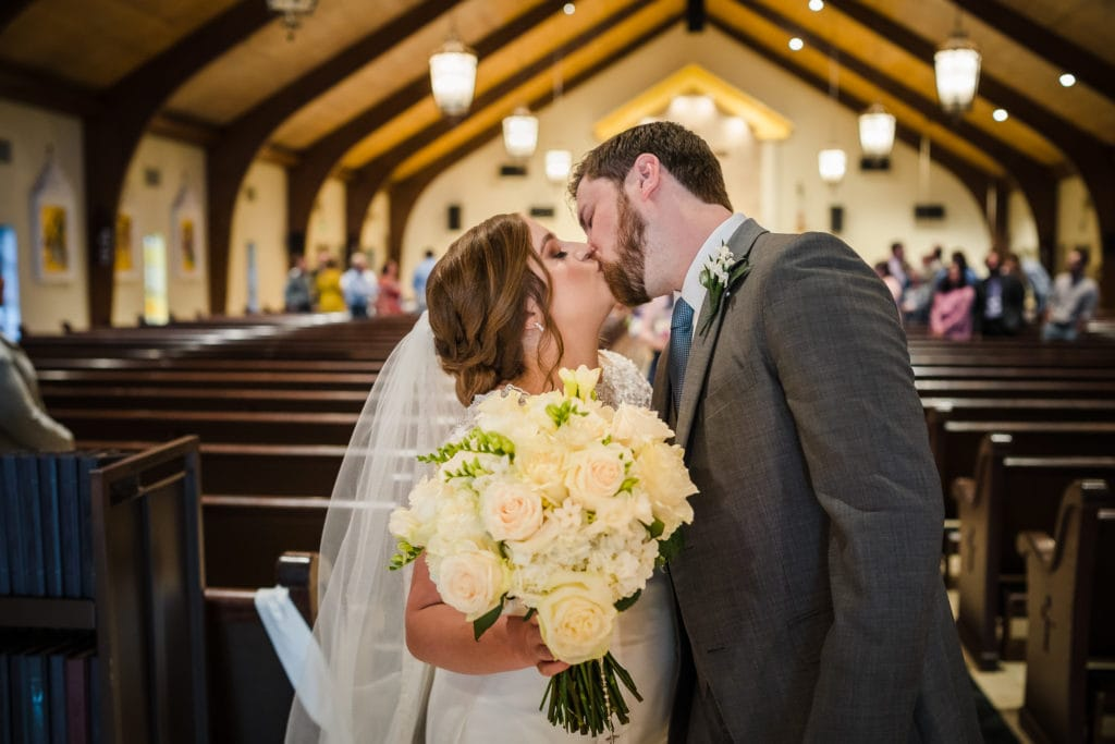 wedding Couple kissing in church