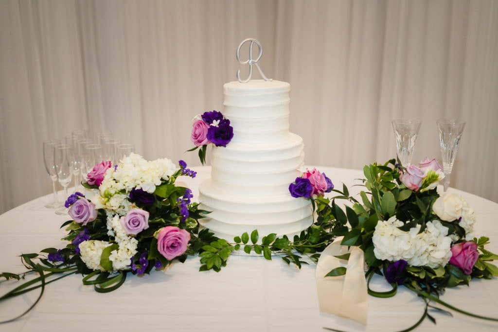 wedding cake with flowers at forrest grove plantation